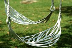 Leaf Swings, they are so cool and unique.  Here's the website for them.  myurbangardendecoguide.com