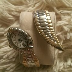 NWOT Silver and gold snake watch This is a new 2 toned snake wrap around watch.  There are back hinges to take on and off and make is so it fits any sized wrist!  Small rhinestones for eyes...an edgy piece for anyone! ! Accessories Watches