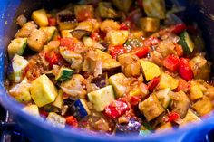 This Indian take on the French classic Ratatouille adds toasted cumin, black mustard and cloves to the vegetarian eggplant, squash and tomato stew.