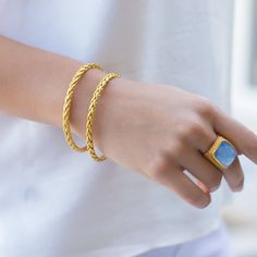 This simple and elegant gilded bangle is plated with 24k gold, and features the Monterey woven motif. Shop this Julie Vos Hallmark piece: