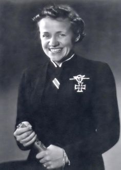 A formal portrait showing Hanna Reitsch (March 29, 1912 - August 24, 1979) wearing the Iron Cross 1st class and ribbon of the 2nd class. Hanna Reitsch was the first female test pilot in the world and suggests the creation of the Nazi equivalent of a kamikaze squad of suicide bombers while visiting Adolf Hitler in Berchtesgaden. https://www.youtube.com/watch?v=4vxxHyl46co / http://en.wikipedia.org/wiki/Hanna_Reitsch