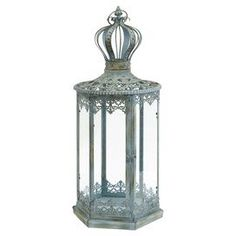 """Wrought iron candle lantern with Victorian-style latticing and a crown finial.   Product: LanternConstruction Material: Wrought iron and glassColor: Antique blueAccommodates: (1) Pillar candle each - not includedDimensions: Small: 30"""" H x 12"""" DiameterLarge: 36"""" H x 12.5"""" Diameter"""