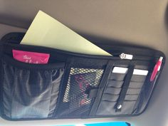 The Made In The Shade Pocket can go on the car visor and hold business cards, pens, tissues, etc. THIS is what car visors were made for. ;)  www.mythirtyone.com/AmandaPrim