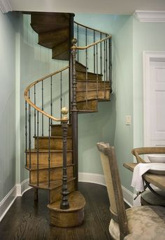 Antique spiral staircase in a home designed in Myrtle Beach, SC designed by Kimberly Grigg