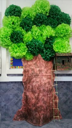 A classroom tree display - tissue paper pom poms were used for the leaves (purchased from KMart), and large sheets of painted cardboard was used for the trunk and stuffed with pillows to create a 3D trunk. This is part of our Magic Tree House display - not linked to a website.
