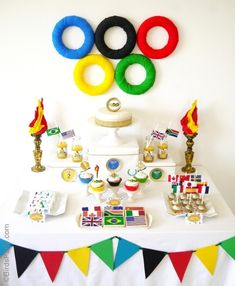summer-olympics-party-dessert-table Ah! I so want to do this for my Sport Education classes someday. I want to have an Olympic theme for my PE classes! Party Printables, Olympic Idea, Olympic Games, Olympic Crafts, Bird Party, Going For Gold, Sports Party, Sports Birthday, Winter Olympics