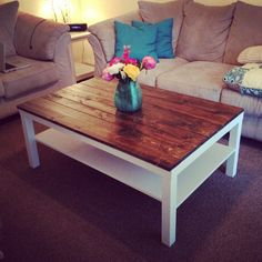 Ikea hack. Plain white coffee table from Ikea with stained cedar planks secured to the table top.
