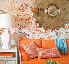 white, orange & blue living room with a splash of gold.