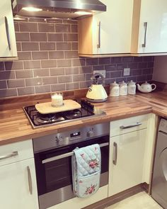 high gloss, grey brick tiles and wooden worktops
