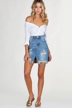 MUST HAVE/CURRENT FAVORITE: Hi rise denim skirt with trendy distressing and center slit for added detail. Raw hem all around with zip and button for closure.