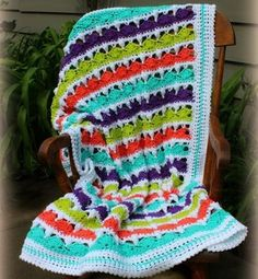 This crochet cluster stitch baby afghan pattern is super summery and fun!