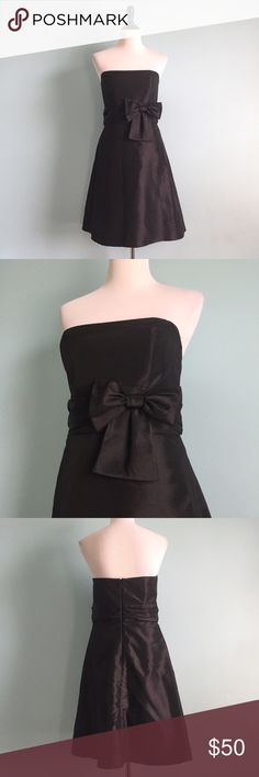 Amsale Black Bow Dress Amsale black Strapless below-the-knee dress with big bow in waistline. Super cute! Size 10, fits a little small though. Great for any special occasion! Will take measurements for serious buyers. Amsale Dresses Strapless