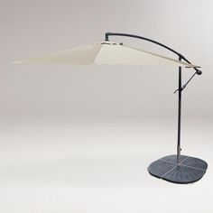 One of my favorite discoveries at WorldMarket.com: 10' Natural Cantilever Umbrella and Weight Base