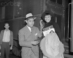 """Joe Louis greets Edna Mae Harris, actress on her arrival to become Joe's leading lady in his first picture """"The Spirit of Youth"""". Black Actresses, Black Actors, Hattie Mcdaniel, Heavyweight Boxing, The Falling Man, Joe Louis, Turner Classic Movies, Vintage Black Glamour, Star Trek Movies"""