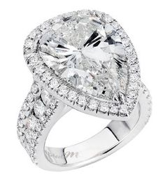 Michael M 18k white gold Halo Design ring with a 2ct pear shape center diamond.