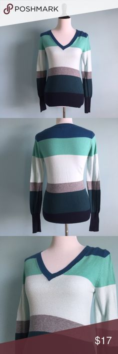 """V-Neck Blue & Green Striped Sweater Colorful v-neck striped sweater. Comfortable and flattering. Shades of teal, turquoise, light blue, grey and navy. Size small by Mossimo Supply Co. In good condition Waist: 30 inches Bust: 31"""" Length: 23.5"""" Mossimo Supply Co. Sweaters V-Necks"""
