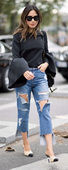 bell sleeve shirt with torn denim and heels