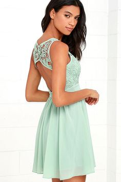 You can't help but hum a happy tune when you take a twirl in the Jolly Song Sage Green Lace Skater Dress! Elegant crocheted lace tops a sweetheart silhouette atop a lightly padded bodice with darted detail. Lovely chiffon fabric falls from a banded waist into a flirty skater skirt. Three hook clasps join above an open back. Hidden back zipper with clasp.