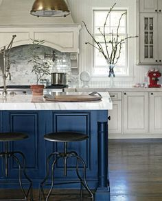 White cabinets with the blue island!