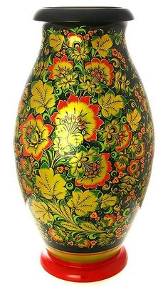 A wooden vase decorated with folk Khokhloma painting from Russia. #Russian #folk…