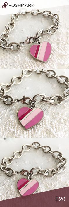 """Coach Multi Pink Stripe Heart Charm Bracelet 🎀NOTE TO BUYERS... all my items are marked to lowest price. PLEASE DON'T MAKE OFFERS, MY PRICE IS FIRM. Thank you and have a Wonderful Day!🎀  100% Guaranteed Authentic Coach Multi Pink Stripe Heart charm on CUSTOM silver with rhodium finish (will not lose shine and resists tarnishing) link 8"""" bracelet with lobster closure clasp. No box.   I can adjust to ANY SIZE needed.... Just ask. Chunkier style bracelet  Take a peek at my other listings for…"""