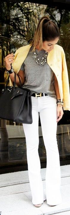 Sophisticated day style. Statement necklace, yellow jacket, white trousers, and Hermes belt.