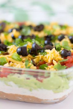 Easy healthy seven layer dip recipe packed with flavor and nutrition. This bean dip with Greek yogurt, cheese, tomatoes & more is perfect for any gathering! Healthy Dip Recipes, Healthy Dips, Healthy Appetizers, Kid Recipes, Yummy Recipes, Healthy Food, Healthy Eating, Seven Layer Bean Dip, Layered Bean Dip