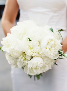 Elegant all-white peony bouquet: http://www.stylemepretty.com/vault/gallery/38475 | Photography: Judy Pak - http://judypak.com/