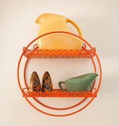 Upcycled round retro shelf. (not a direct link to post. Post here: http://www.piewacketblog.com/journal/2012/1/6/shelf-life.html)