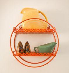 LOVE this orange circle shelf!!