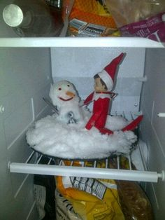 Our crazy Elf on the Shelf is in the freezer tonight.. building a snow man.  I guess he really misses the north pole.  I'm sort of amazed he found enough freezer space for this project actually...