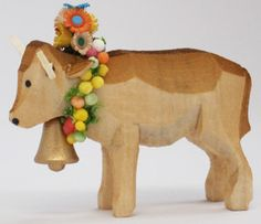 Almabtrieb Cow / Kuh with Headdress. A cow as cows are adorned for the return from summer pasture in the Alps. This hand-carved cow is very special with its elaborate headdress and is from the workshop of Hartmut Henning, Erzgebirge, Germany. Available at www.mygrowingtraditions.com