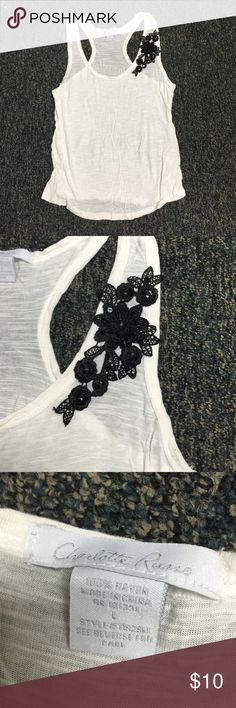 White tank with black detail on one shoulder White racer back tank with black detailing on one shoulder. Super flattering fit! Size large Charlotte Russe Tops Tank Tops