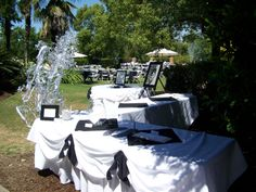 Entrance of Event with Registration Table / Mempry Table / Money Tree / Gift Table all in White Linens bunted with Black Accents