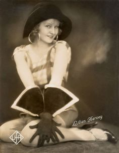 Lillian Harvey 1920's those gloves, hat and smile. Not to mention the ear-rings