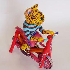 Martin Melchor - Hand Carved Jaguar Riding a Bike – COSAS Mexican Art