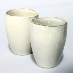 Broste Two Off-White Hand Finished Ceramic Cups: Two hand decorated ceramic cups. These beautiful ceramic cups have a rustic organic feel with a smooth gently undulating rim. Each one is hand finished and unique in shape and colour, glazed in a soft off white with a mocha rim.