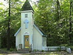 HOUGHTON LAKE, MICHIGAN.... This charming Historical Chapel was built the old fashioned way, by a community effort and can accommodate 35 people. It is available for modern day weddings and other services. Chapels like this one were often the Center of life in the Village and was not only a place of worship but was the social center of the community The Chapel Bell and pews all donated items. During Village Days there is a Sunday morning service in the chapel with traditional Gospel Music.