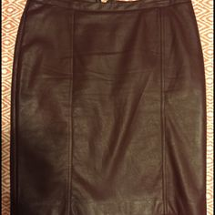 """Burgundy faux leather pencil skirt Beautiful faux leather pencil skirt in burgundy. Back zipper closure. 16"""" waist. 21"""" length. Fully lined. Small tear at slit (see last pic). Worthington Skirts Pencil"""
