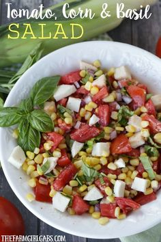 Garden fresh Tomatoes, corn and basil pair up to form the perfect trio in this delicious Tomato Corn And Basil Salad!