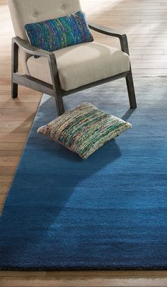 The exquisitely color-shaded ombré of designer Jamie Durie's Horizon Big Blue Area Rug creates a soft, comforting anchor to a room.