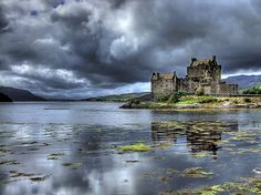 Scotland. This is Eilean Donan Castle... My ancestors, Clan Macrae were the castle guards and now own it today. Hopefully one day I'll be able to see it in person :)