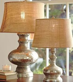 Cheap dollar store lamps, mirrored spray paint, burlap covered shades