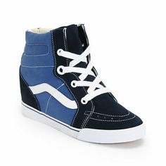 """Put a new spin on a classic look with the Sk8-Hi Navy and True White wedge shoes from Vans. These girls wedge shoes from Vans are made with a 3"""" heel and a micro-waffle tread for while the upper is made of a textile and suede material for a comfortable yet bold look you can rock anywhere."""
