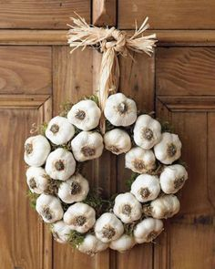 green-halloween-garlic-wreath    Ward off vampires with an odiferous warning that they're not welcome at your door. Garlic that still has its dried greens can be braided onto a wreath as explained by Garden Wise Online, or you can hot-glue heads of garlic onto a wreath form.