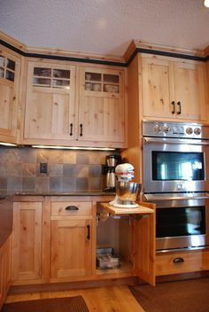 The knotty alder cabinets with glass panes complement the subtle elements of the…