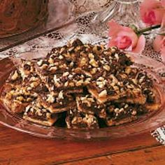 Saltine Cracker Chocolate Candy Recipe (sounds crazy but it tastes a lot like Toffee): Saltines, butter, brown sugar & chocolate chips  My Alterations: I used milk choc chips, no nuts & baked at 400 degrees for 5 minutes. You really do have to let it cool completely before eating.