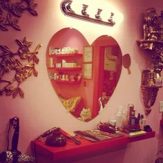 Make shift vanity with heart shaped mirror
