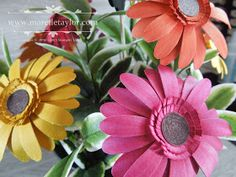 Paper gerbera daisy made with   Stampin Up daisy punch.