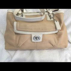 Coach Penelope Beautiful coach purse tan & white, soft leather beveled! Silver hardware! Purple interior! Shoulder straps very classy summer time purse unless you live in a 24 -7 warm climate me I live where it still snows in May...lol . Please use the offer button! I'm sorry I'm not a model either so refrain from asking! Please don't lowball remember this 20% goes to posh! Coach Bags Shoulder Bags